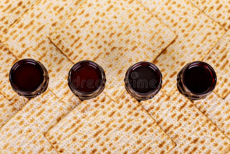Matzot four glasses of red wine symbols of Passover stock photo