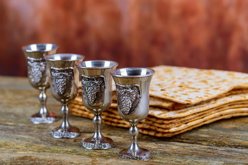 Matzot four glasses of red wine symbols of Passover royalty free stock photos