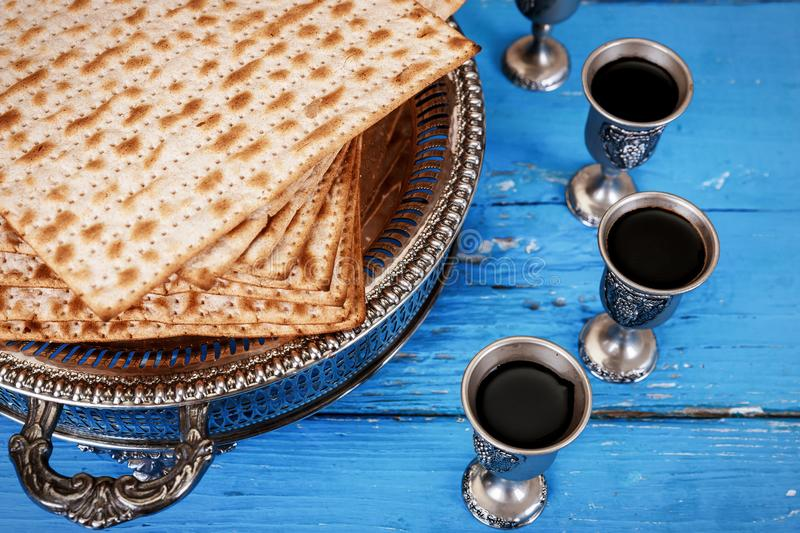Matzot and four glasses red wine symbols of Passover royalty free stock photography