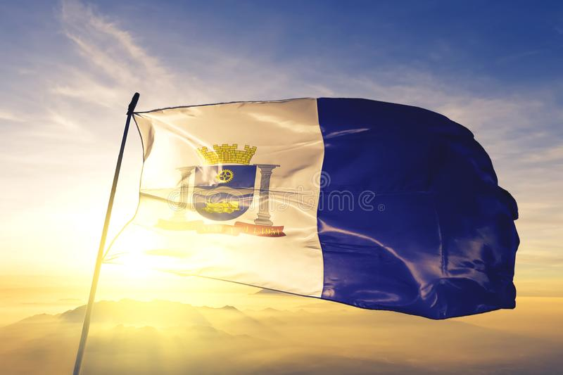 Maua of Brazil flag waving on the top sunrise mist fog. Maua of Brazil flag textile cloth fabric waving on the top sunrise mist fog royalty free stock photos