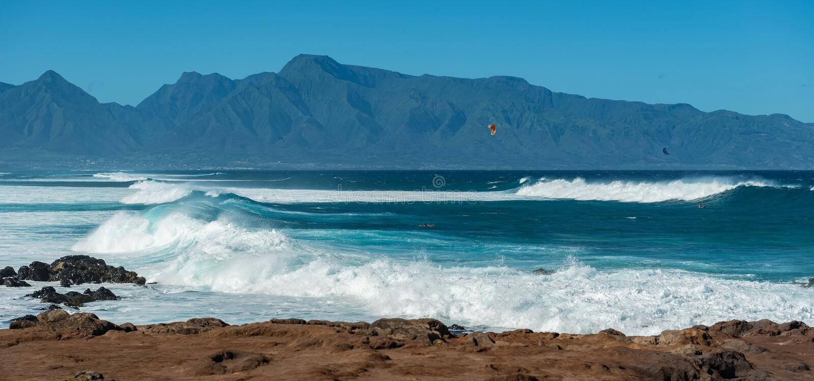 MAUI, HAWAII, USA - DECEMBER 10, 2013: Surfers are riding waves royalty free stock photography