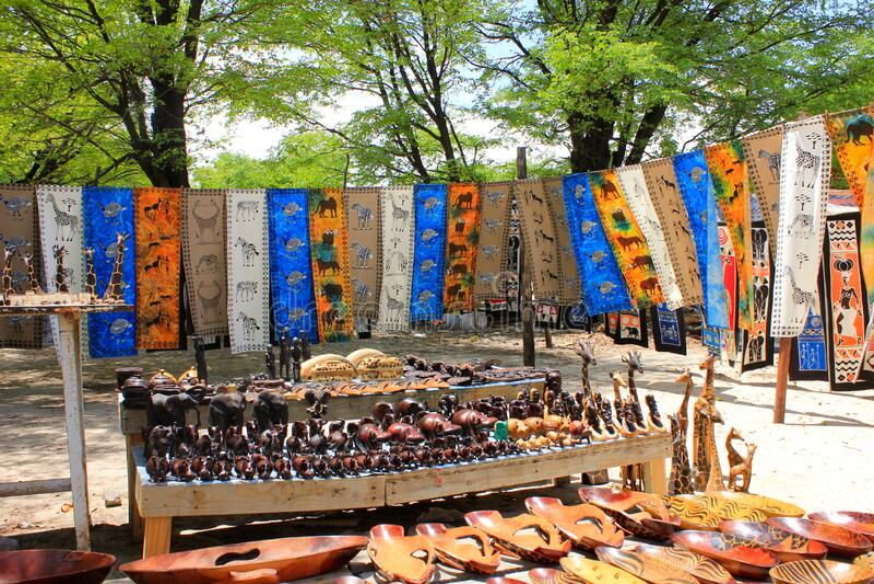 Maun Botswana, Street sellers selling curios and African prints. Maun, Ngamiland,/ Botswana- December 09-2019 Street sellers selling curios and African prints by royalty free stock photo