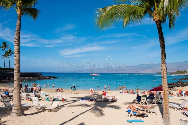 Crowded Mauna Lani Beach Big Island Hawaii. MAUNA LANI BAY, HAWAII - JANUARY 5, 2018: Mauna Lani Beach is very crowded on a warm day on the Big Island of Hawaii stock photo
