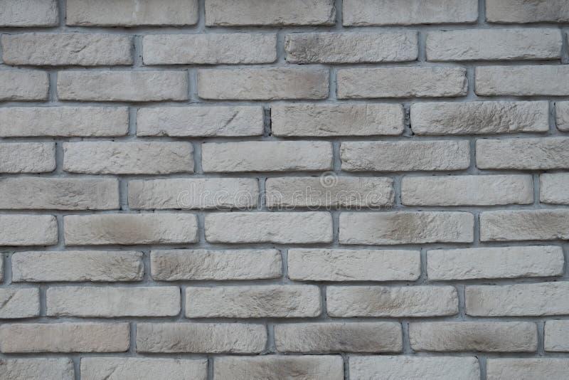 Maurerarbeit, Backsteinmauer, Hintergrund, graue Ziegelsteine, weiße Ziegelsteine stockbild