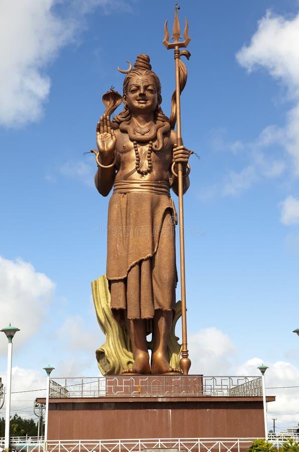 mauritius Estatua de Shiva en el templo magnífico de Bassin del lago imagenes de archivo