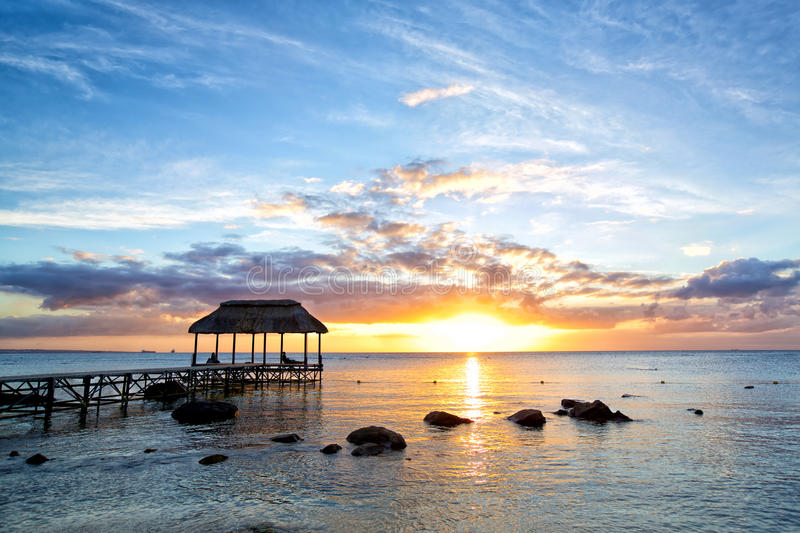 Mauritius sunset. Beautiful sunset with jetty in Mauritius Island stock photo