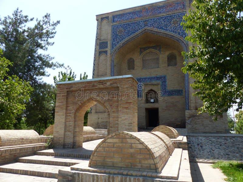 Mausoleum of  Kaffal - Shashi with graves outside in Tashkent. Uzbekistan. stock photography