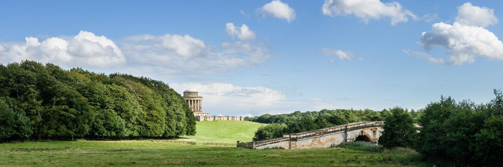 Mausoleum and New River Bridge - Castle Howard - North Yorkshire - UK. The Mausoleum and New River Bridge on a hot summers day, Castle Howard, North Yorkshire stock photography