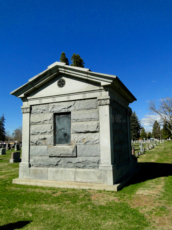 Mausoleum. A stone mausoleum stands in the midst of an old Idaho cemetery stock image