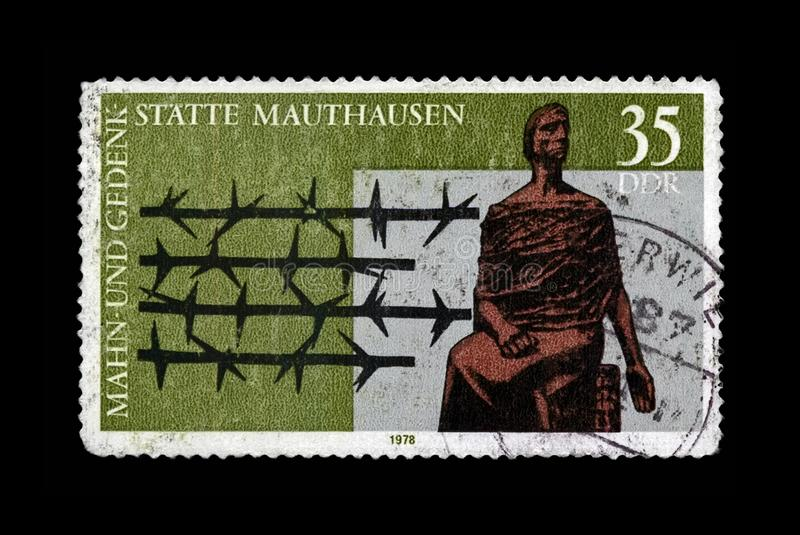 Mauthausen concentration camp Memorial, barbed wire, DDR, circa 1978,. DDR - CIRCA 1978: vintage canceled stamp printed in DDR shows Mauthausen concentration stock image