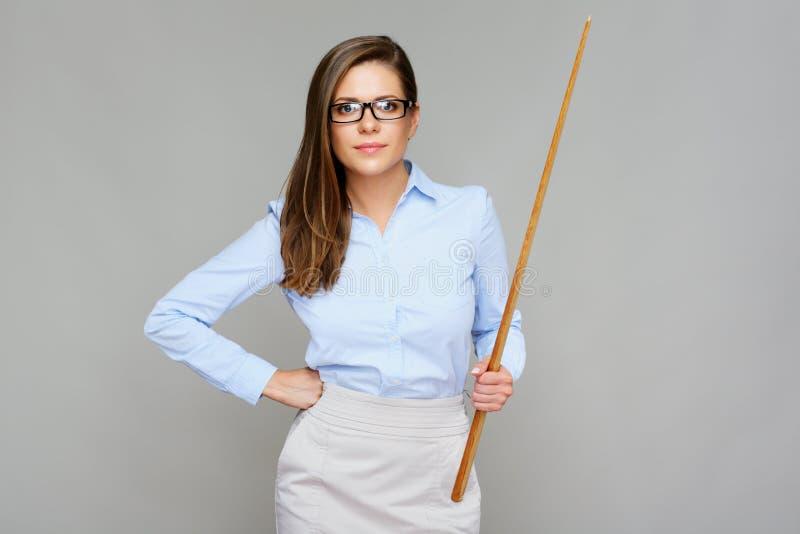 Mauvais professeur Femme tenant l'indicateur en bois images stock