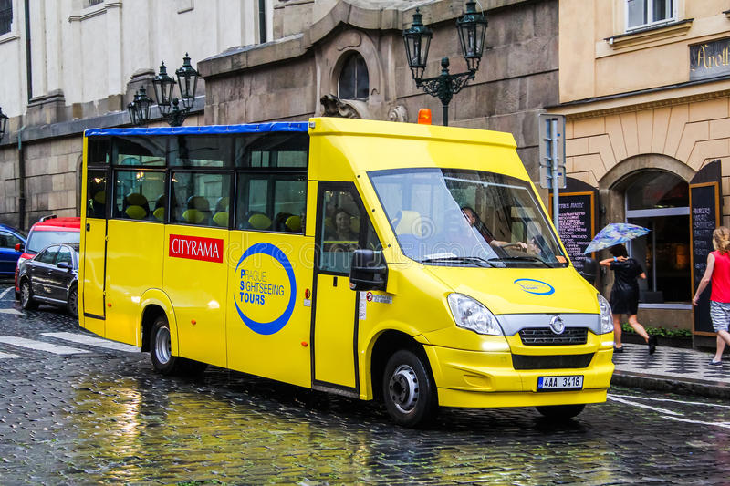 Mave (Iveco Daily). PRAGUE, CZECH REPUBLIC - JULY 21, 2014: Small sightseeing bus Mave (Iveco Daily) at the city street stock photography