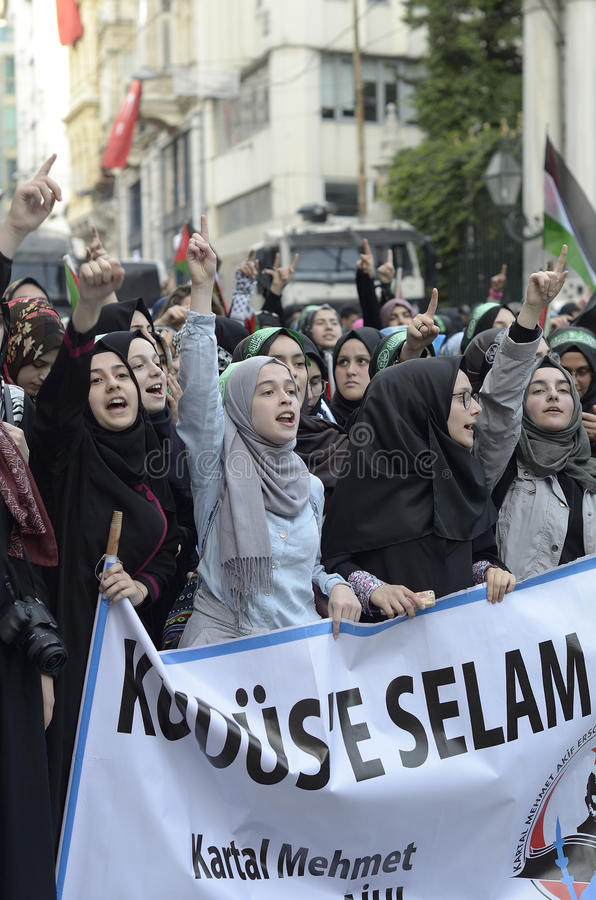 Mavi marmara manifestation X A. Istiklal Street, Istanbul May 28, 2016, Turkish young women shouting God is the greatest in the demonstration for the sixth