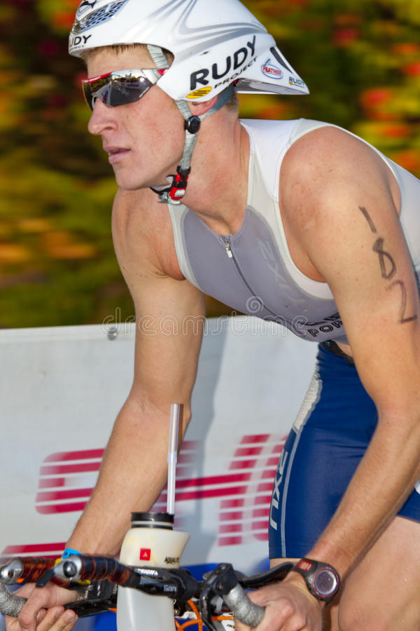 Max Biessmann Racing in the Arizona Ironman Triath. TEMPE, AZ - NOV. 22: Unidentified competitor in the cycling stage of the Phoenix Ironman Triathlon on stock photos