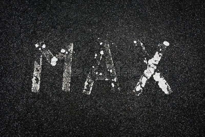 'Max' painted on a road. The word 'max', worn and faded, painted in white on a tarmac road stock images