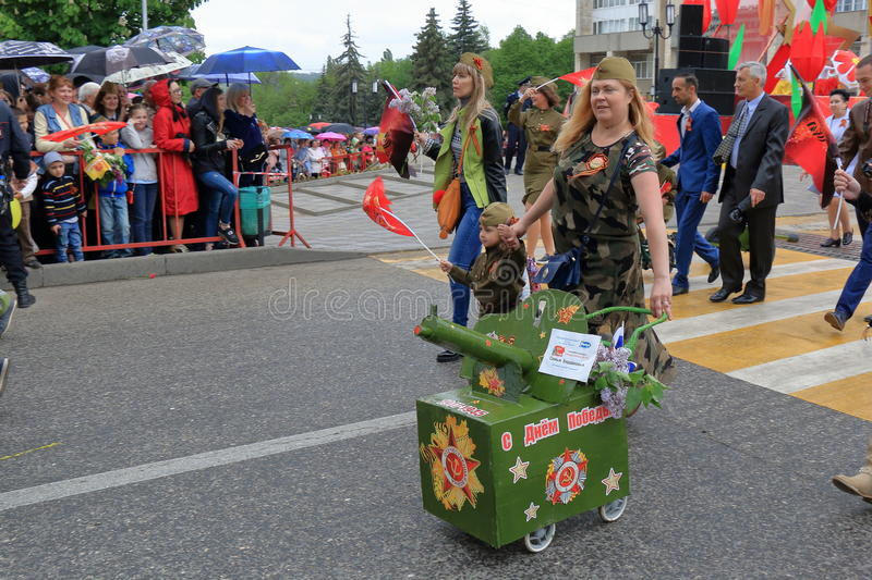 Maxim gun. Parade of Baby Strollers -2017 in Pyatigorsk, Russia. Pyatigorsk, Russia - May 9, 2017: Maxim machine gun. Participants of the contest `Parade of Baby royalty free stock photography