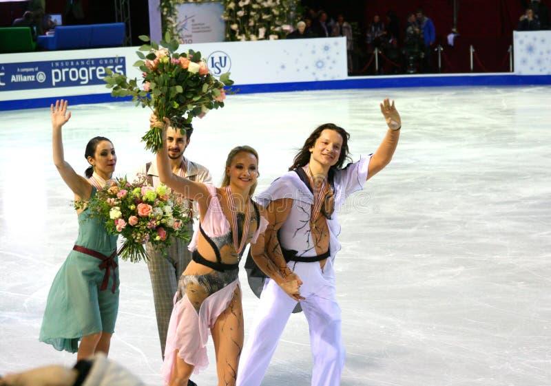 Maxim Shabalin and Oksana Domnina with gold medals. ISU European Figure Skating Championship 2010 in Tallinn, Estonia. Maxim Shabalin and Oksana Domnina from royalty free stock photography
