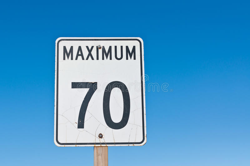 Maximum 70 Sign. A traffic sign with a cracked surface reads Maximum 70 royalty free stock photography
