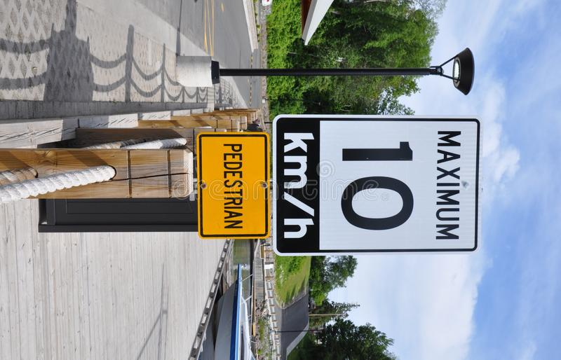 Maximum 10km/hr sign. Post along the road royalty free stock photography