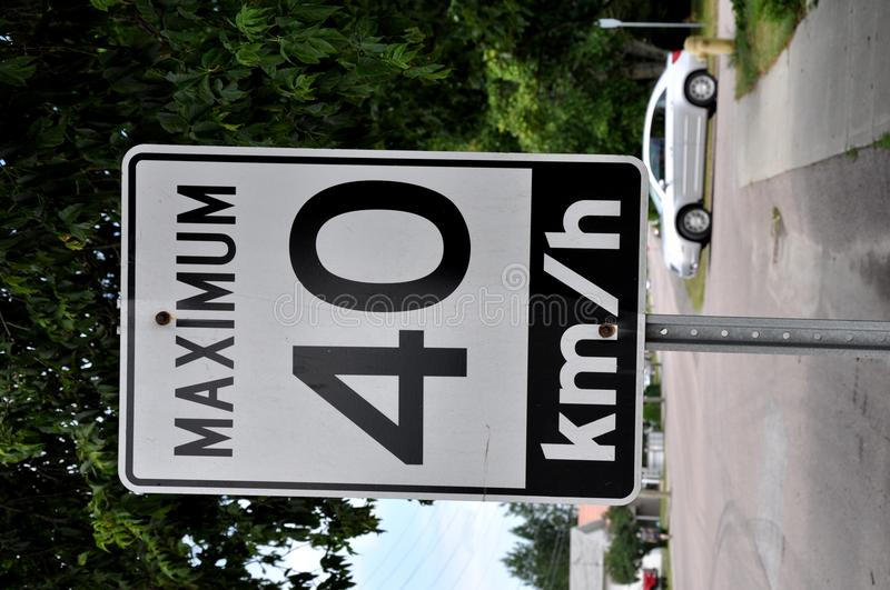Maximum 40 km/hr sign. Posted along the street stock photos