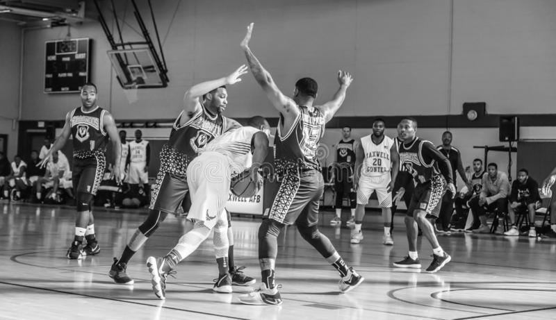 Maxwell Air Force Base Gunter Annex  Basketball Team Action Shots in Black and White. Montgomery, ALABAMA - JANUARY 26, 2019: Action shots of the Maxwell Air royalty free stock photography