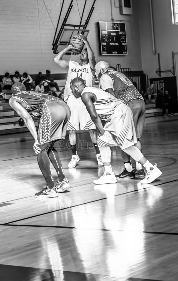 Maxwell Air Force Base Gunter Annex  Basketball Team Action Shots in Black and White. Montgomery, ALABAMA - JANUARY 26, 2019: Action shots of the Maxwell Air royalty free stock photo