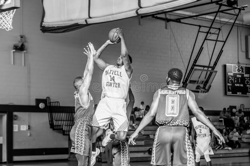 Maxwell Air Force Base Gunter Annex  Basketball Team Action Shots in Black and White. Montgomery, ALABAMA - JANUARY 26, 2019: Action shots of the Maxwell Air royalty free stock images