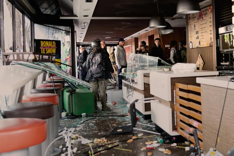 May 2018 - Anti Macron protest in Paris. Restaurant Mc Donald vandalized in Paris during the Anti Macron Protest parade royalty free stock images