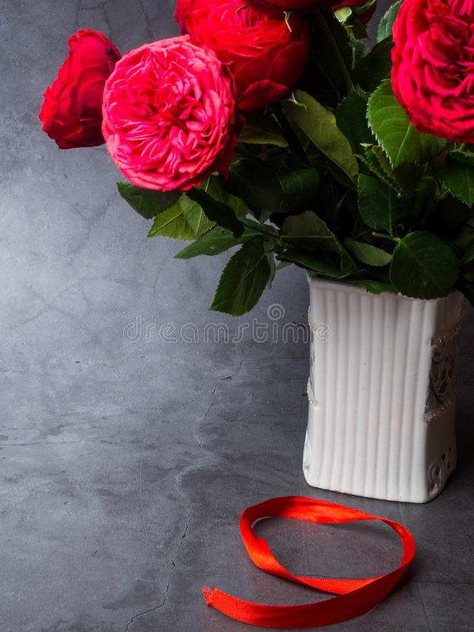 9 May background - red roses and red ribbon on the concrete background, free space for text stock image