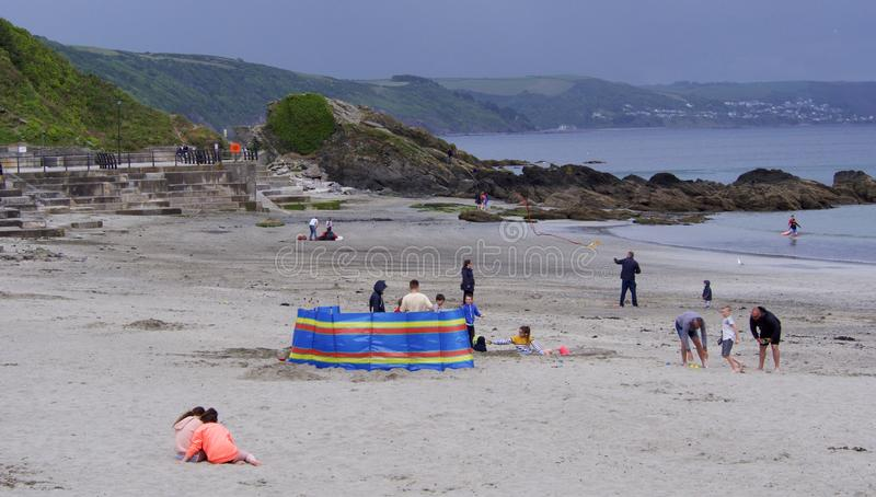 May Bank Holiday tourists making the most of it, Cornwall. Looe, Cornwall, UK. 05.27.2019 Bank Holiday Monday overcast with a little rain still people at the royalty free stock image
