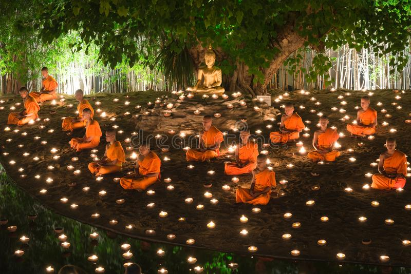 May 13,2014 Chiang mai, Thailand : Monks doing religious ceremony among Candle light on Visakha Puja Day at Wat Phan Tao temple. Chiang mai, Thailand stock photo