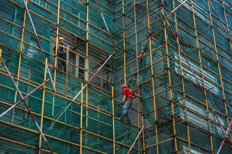 Laborers on scaffolding. On May 19, 2018, a construction site on Hunan Road, Nanjing, China, several workers were working on scaffolds