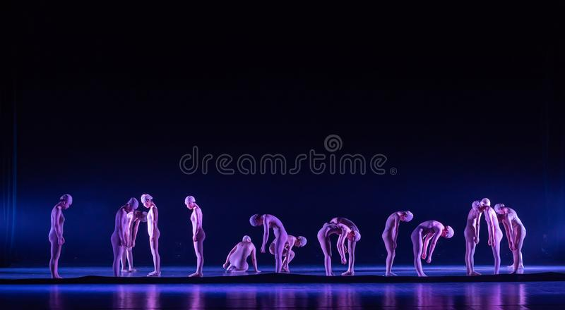 Wake up in a dream-Huang Mingliang`s dance`No shelter`. In May 25, 2018, the dance drama `no shading` was staged at the theater of Jiangxi science and technology stock photography