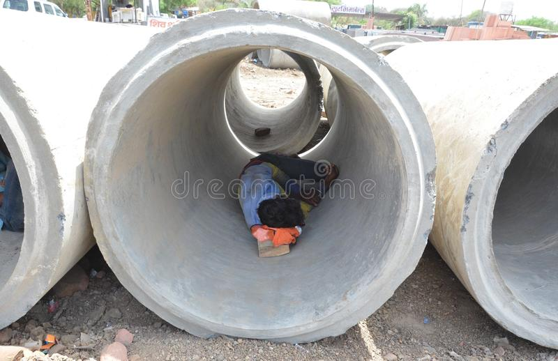 May day. Construction Labour sleep in a concrete pipe in a very hot day in Bhopal, India stock photo