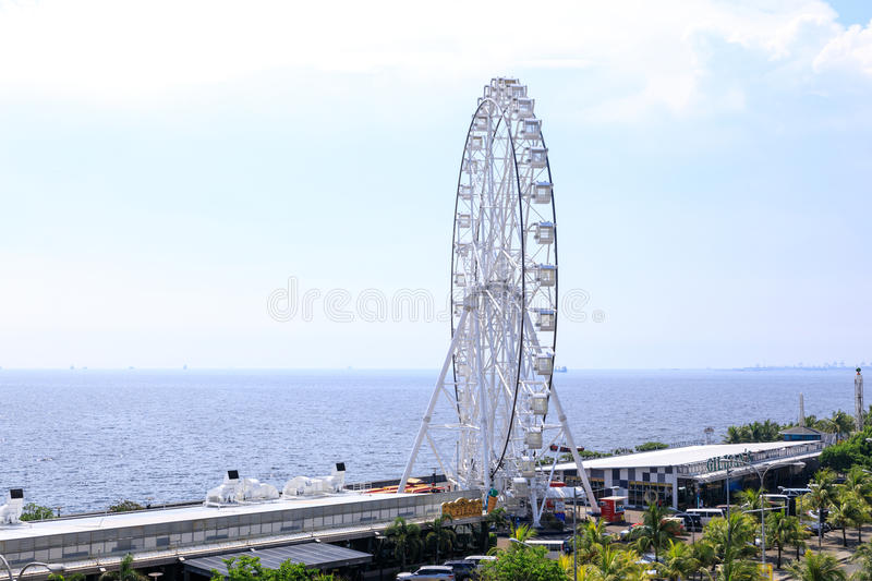 May 31, 2017 Ferris wheel at Mall of Asia in Manila. The ferris. Wheel is situated near Manila Bay royalty free stock image