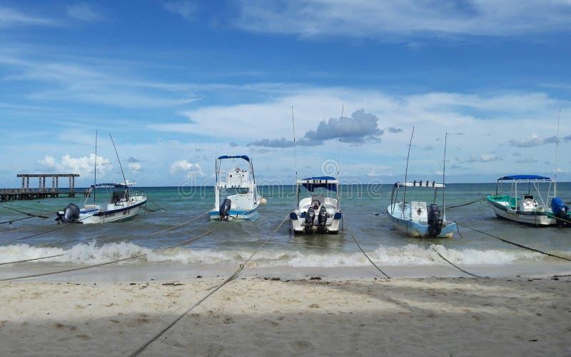May 2017 - Five boats docked on the beach of Playa del Carmen, Mexico stock photography