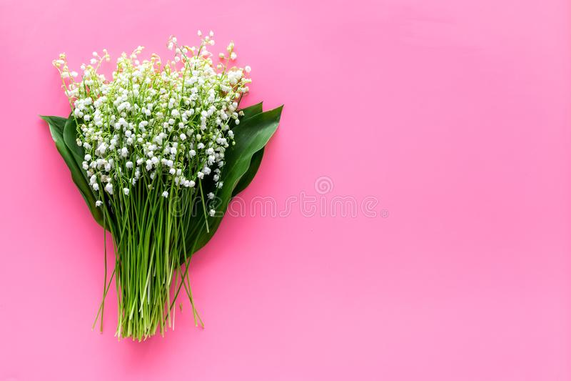 May flowers. Bouqet of lily of the valley flowers on pastel pink background top view copy space. May flowers. Bouqet of lily of the valley flowers on pastel pink royalty free stock photos