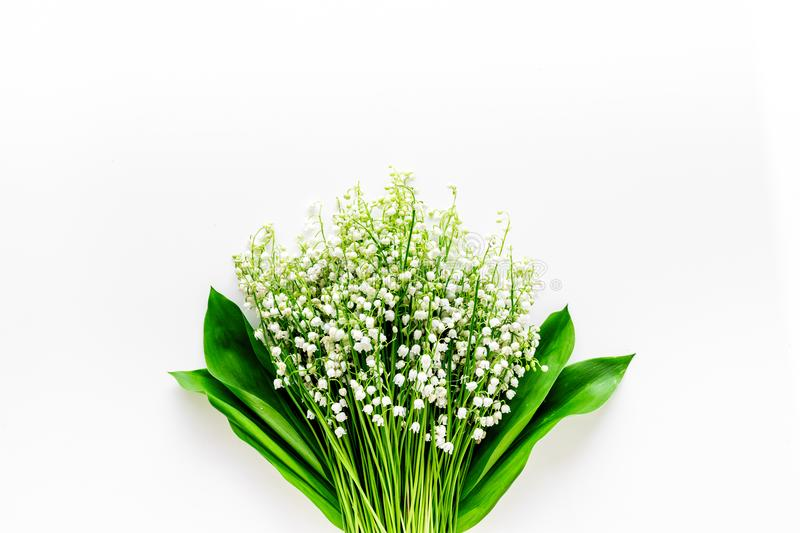 May flowers. Bouqet of lily of the valley flowers on white background top view copy space. May flowers. Bouqet of lily of the valley flowers on white background stock photos