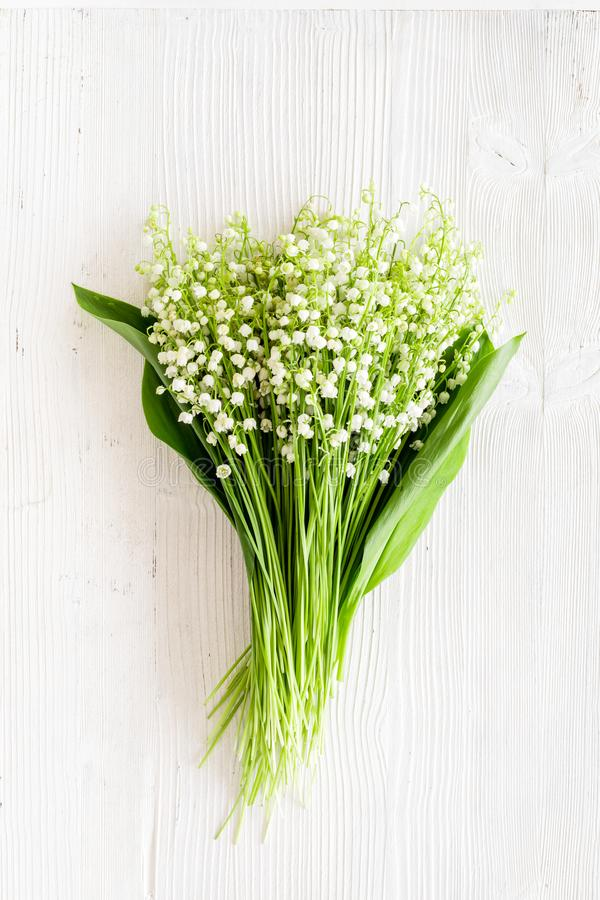 May flowers. Bouqet of lily of the valley flowers on white background top view copy space. May flowers. Bouqet of lily of the valley flowers on white background stock image