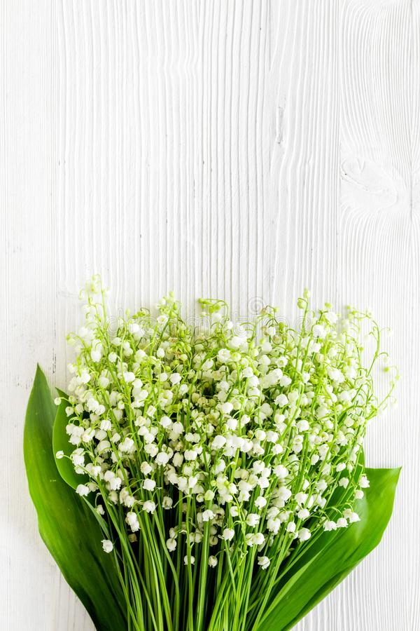 May flowers. Bouqet of lily of the valley flowers on white background top view copy space. May flowers. Bouqet of lily of the valley flowers on white background royalty free stock image