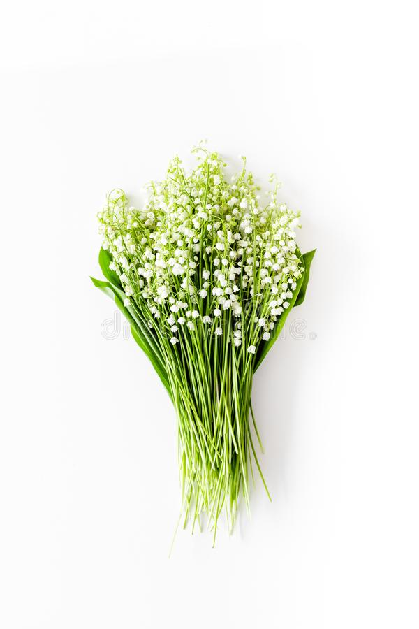 May flowers. Bouqet of lily of the valley flowers on white background top view copy space. May flowers. Bouqet of lily of the valley flowers on white background stock images