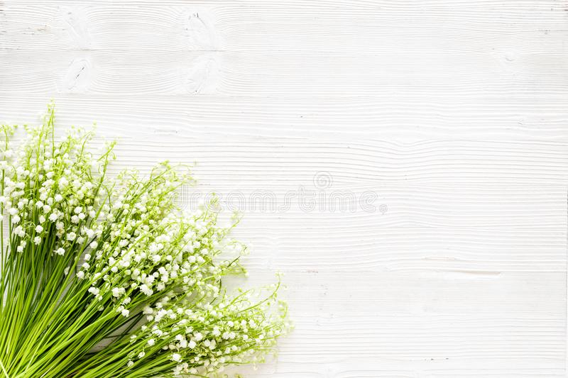 Small and fragrant spring flowers. Bouqet of lily of the valley flowers on white background top view copy space. May flowers. Bouqet of lily of the valley stock photography