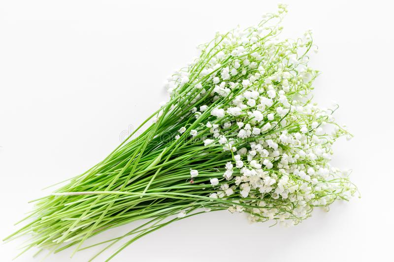 Small and fragrant spring flowers. Bouqet of lily of the valley flowers on white background top view copy space. May flowers. Bouqet of lily of the valley stock images