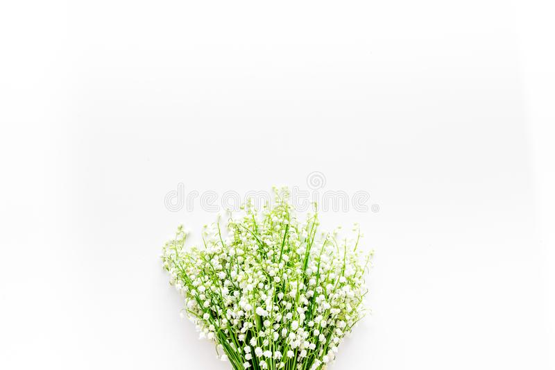 Small and fragrant spring flowers. Bouqet of lily of the valley flowers on white background top view copy space. May flowers. Bouqet of lily of the valley royalty free stock photos