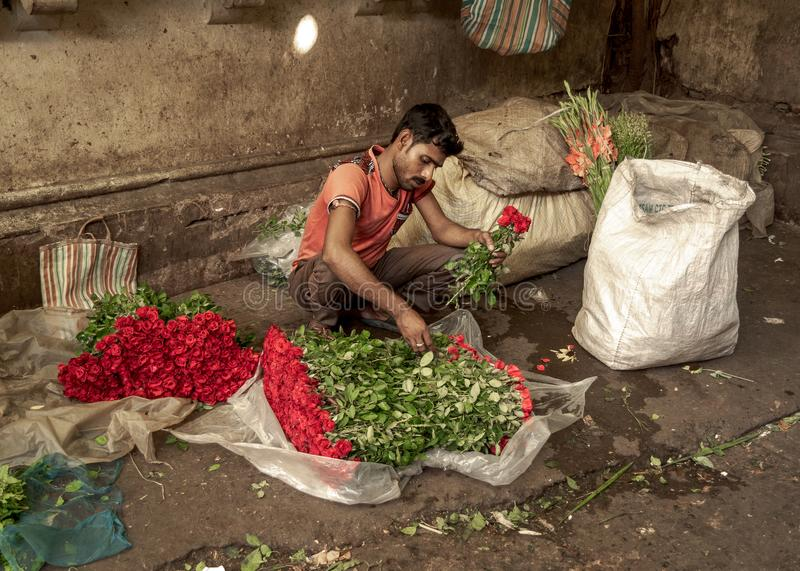 Flower market Or Mullick Ghat, Kolkata. May 27,2018. Kolkata, India. Flower whole sellers busy with flower binding at Flower Market or Mullik Bazar , Kolkata stock image