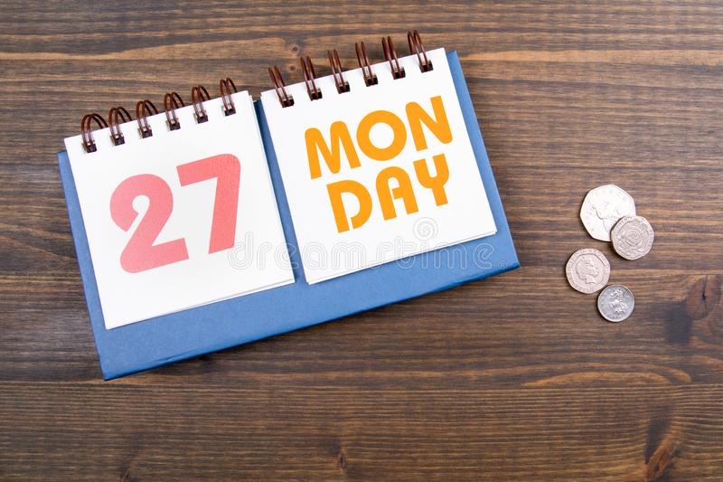 27 May, Monday, Spring bank holiday in UK. Paper calendar on wooden table royalty free stock photography