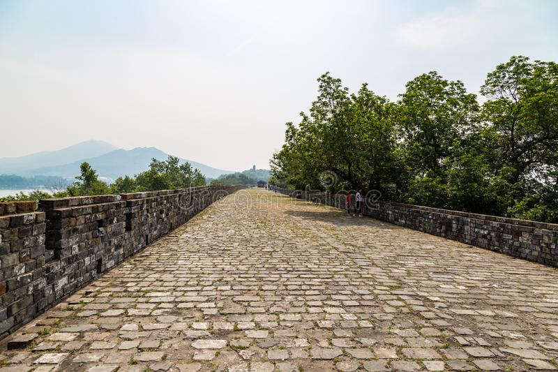 May 2017 - Nanjing, Jiangu, China - tourists walk on a section of the old Ming Dynasty city walls royalty free stock images