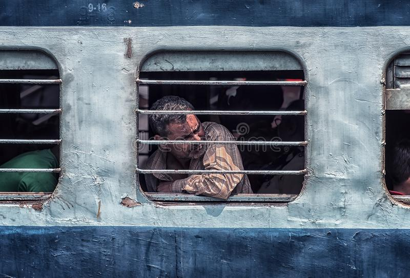 Traveller in second class car. May 2018 - New Delhi, India - Second class car in New Delhi railway station stock photos