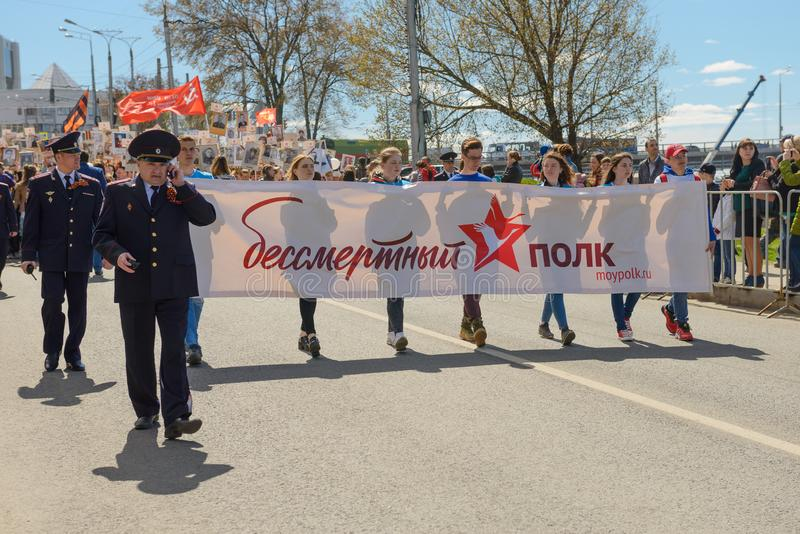 People at the action `Immortal Regiment` in honor of the veterans of the Great Patriotic War of 1941-1945. May 9, 2018: People at the action `Immortal Regiment` royalty free stock photography