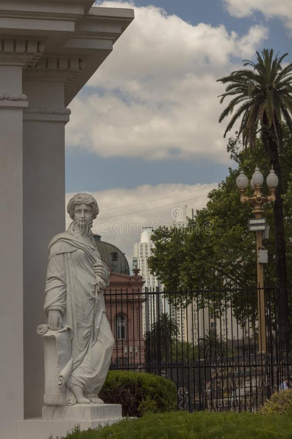 May Pyramid in Plaza de Mayo Buenos Aires, Argentina. Is the oldest national monument in the City of Buenos Aires. Allegory of geography in carrara marble. Pink stock photography